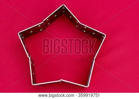 Gold Star From Metal Corners On A Red Background. 5-ray Star With Place For Text. Christmas Star Mad