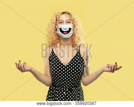Happy Laugh. Portrait Of Young Caucasian Woman With Emotion On Her Protective Face Mask Isolated On