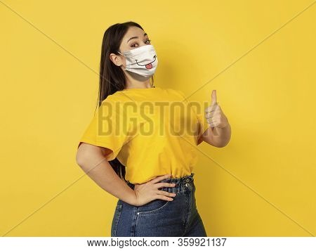 Pointing Happy. Portrait Of Young Caucasian Woman With Emotion On Her Protective Face Mask Isolated