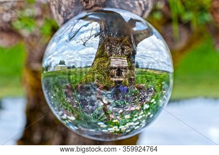Crystal Glass Ball Sphere Reveals Fairy House In Front Of Apple Tree