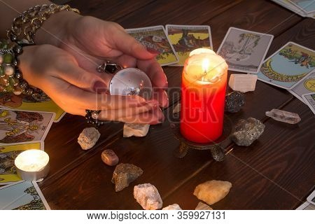 Bangkok,thailand,march.15.20. A Fortune Teller Holds A Magic Ball.on The Table Are Fortune-telling C