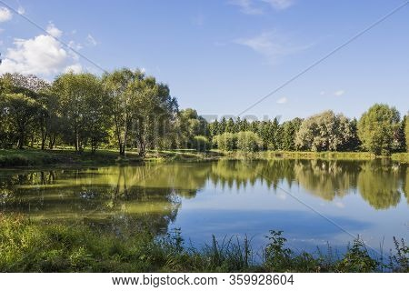 A Beautiful Small Forest Lake With Clear Blue Water In The Forest, A Lava Spring Lake.