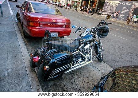 San Francisco, Usa - Sept 30, 2012: Black Harley Davidson Super Glide Motorcycle With Helmet On The