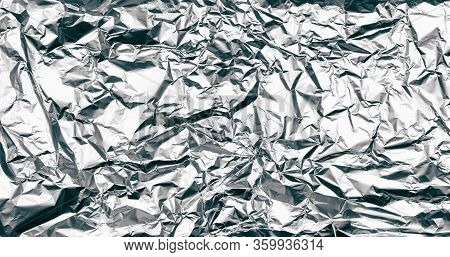 Wrinkled Silver Foil Texture. Grunge Metal Background