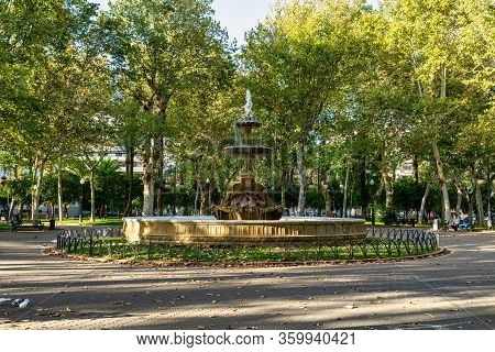 Cordoba, Spain - November 03, 2019: Fountain Situated On The Plaza De Colon Square Inside The Jardin