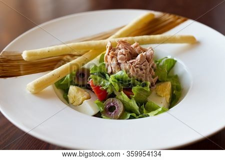 Salad On White Plate On Wooden Table Appetizer