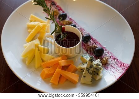 Fruit And Cheese Salad On White Plate