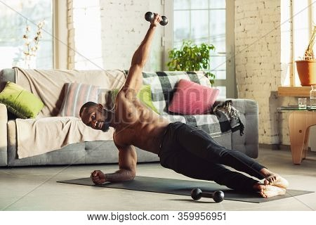 African-american Man Teaching At Home Online Courses Of Fitness, Aerobic, Sporty Lifestyle While Bei