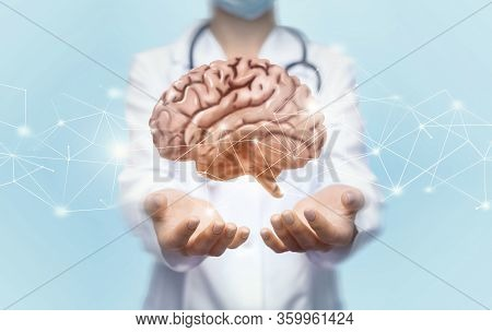 Brain Health Concept. Unrecognizable Female Doctor Holding Brain With Digital Network With Both Hand