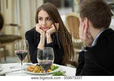 Young Woman Making An Exasperated Expression Gesture On A Bad Date At The Restaurant.