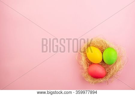 Beautiful Easter Eggs Painted In Yellow, Red And Green Pastel Colors On A Pink Background. Template