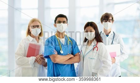 International Doctor Team. Hospital Medical Staff. Mixed Race Asian And Caucasian Doctor And Nurse M