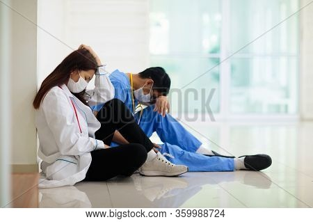 Exhausted Tired Doctor Or Nurse. Virus Outbreak.