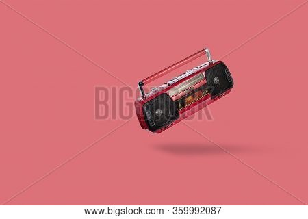 Vintage Radio Cassette Recorder Isolated Over Pink Background. Old Retro Red Radio And Cassette Play