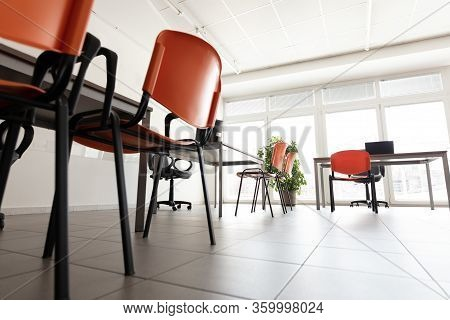 A Low Angle Of A Bright Office Room With No People During The Corona Virus Pandemic.