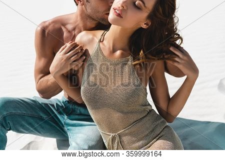 Cropped View Of Passionate Sexy Young Couple Kissing On Beach With Closed Eyes