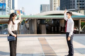 Asian Business Man And Woman Greet And Say Hello With Business Colleague And Wearing Mask Standing D