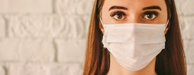 Banner Confident Female Doctor Surgeon In Protective Mask On Face In Hospital. Young Sick Woman In M