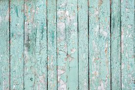 Background From Wooden Boards With Peeling Paint Top View. Green Old Cracked Paint On A Wooden Surfa