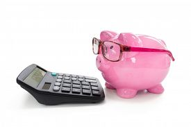 Piggy bank with eye glasses  and calculator concept for saving, accounting, banking and business account
