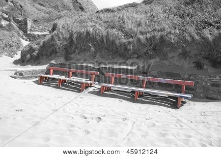 Ballybunion seaside benches and sand drifts on the beach front in black and white poster