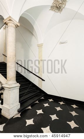 ancient staircase of a classic historic building, interior poster