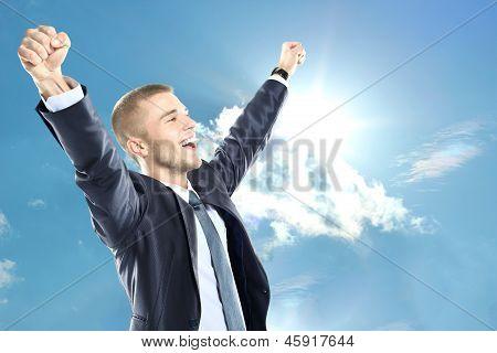 Cheering businessman winning something or having