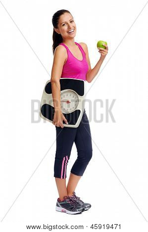 healthy diet eating woman with scale and apple for weightloss