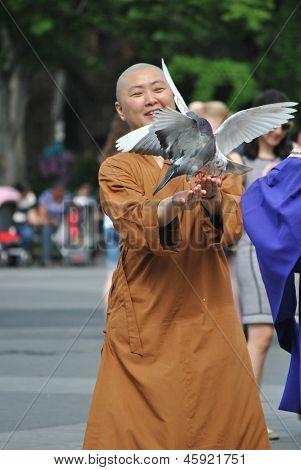 buddhist nun with pigeons