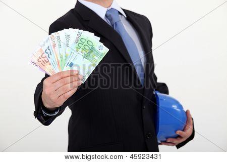 real estate businessman holding money in cash