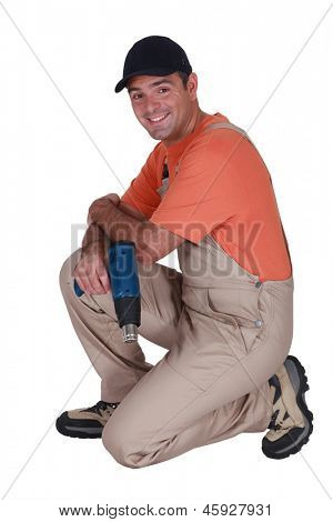 Handyman holding a screw gun