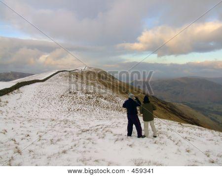 Hikers In Winter Scene