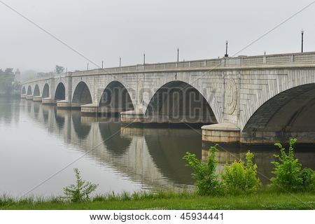 Washington D.C., Arlington Memorial Bridge with reflection on Potomac River in mist - United States of America