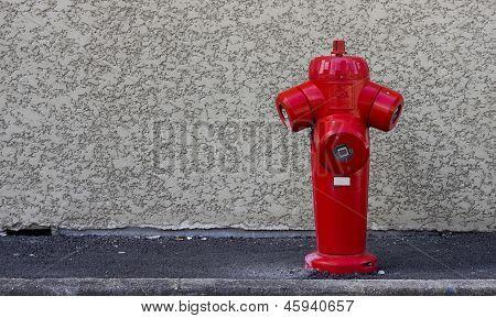 Fire hydrant on the wall background.