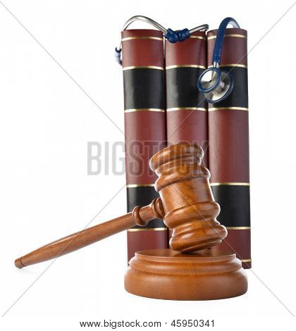 Medicine law concept gavel and stethoscope on books isolated on white background