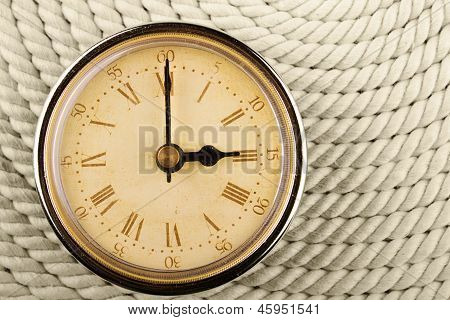 Clock With Roman Numerals On Cord Background. 3