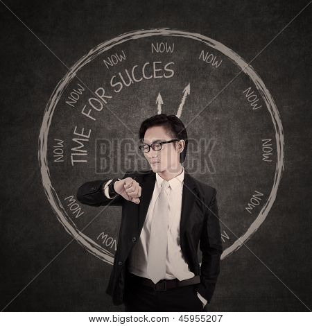 Businessman Checking Out His Watch