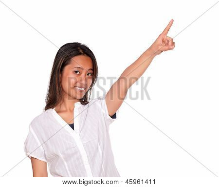 Charming Asiatic Young Woman Pointing To Left Up