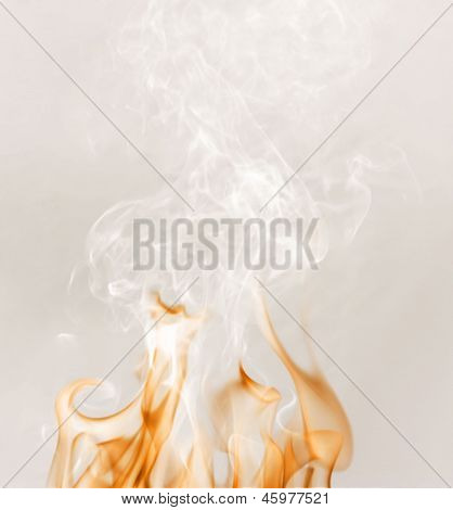 Fire With A White Smoke On A Grey Background