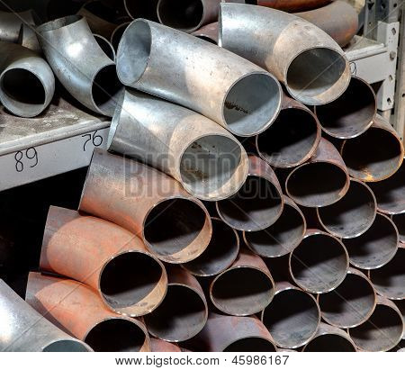 Carbon steel seamless butt welded elbow Material butt-weld pipe fittings. Warehouse for metal piping plumbing heating systems. poster