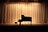 Grand piano at concert stage with brown curtain poster