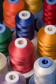 Selective focusing for shallow depth of field on this colorful display of spools of thread poster