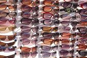 Spectacles sunglasses and Goggles for display at a shop for sale poster