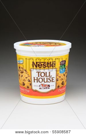 IRVINE, CA - JANUARY 11, 2013: A 5 pound tub of Nestle Toll House Cookie Dough. The popular cookie recipe was developed in the 1930's by Ruth Graves Wakefield of the Toll House Inn.