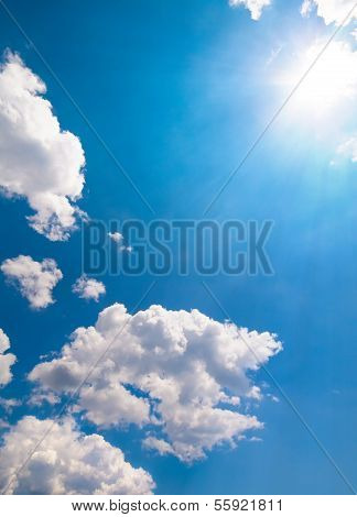 Sun Burst On A Blue Sky And Clouds