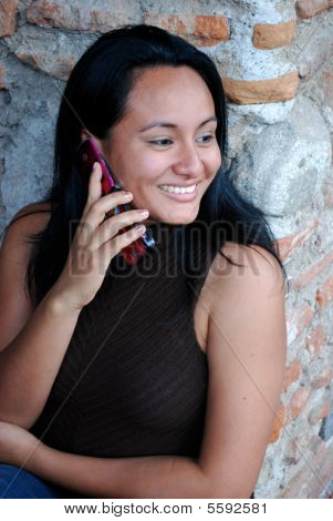 Beautiful Hispanic Girl talking on a cellphone