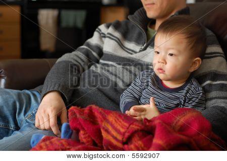 Baby boy watching tv