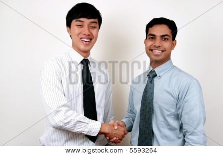 Indian And Chinese Businessman Shaking Hands.
