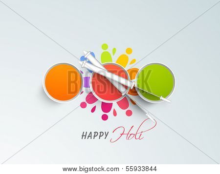 Indian color festival Holi background with buckets with full of colours and pichkari (colour gun) on splash background.