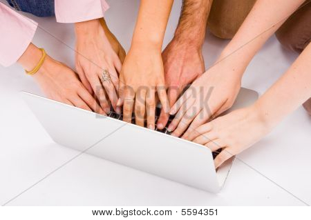 Lot Of Hands With Grey Laptop